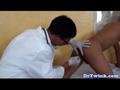 Young asian doctor giving enema